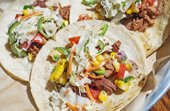 The vegetarian tacos at Oak & Apple feature barbecue jackfruit topped with jalapeño slaw and grilled corn pico de gallo.