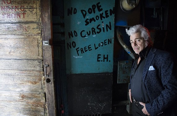 "Dale Watson stands in Memphis near an old sign at Earnestine and Hazel's dive bar upstairs ""where it used to be a whorehouse,"" he says."