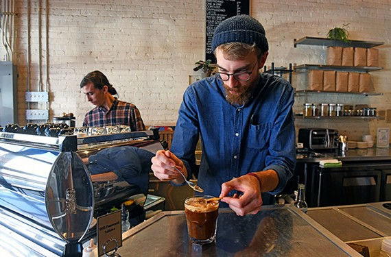 Lamplighter's bar manager, Eric Mason, puts the finishing touches on another masterpiece.