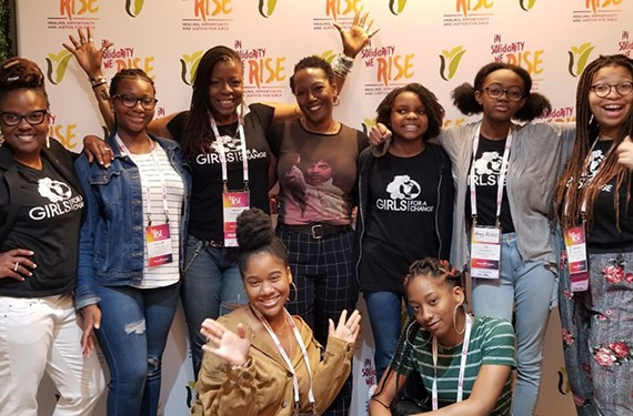 Girls for a Change President and Chief Executive Angela Patton, at far left, and author and filmmaker Monique Morris, at center, are pictured with local members of Girls for a Change, a nonprofit dedicated to changing the lives of black girls.