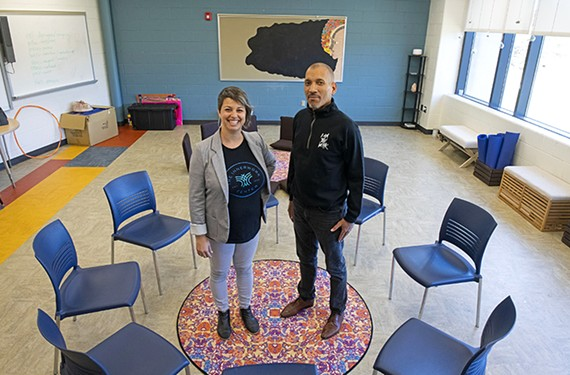 Rachel Douglas, executive director of the nonprofit Innerwork Center, stands next to Ram Bhagat, the school system's manager of school culture and climate. The pair hope to help students engage in compassionate listening.