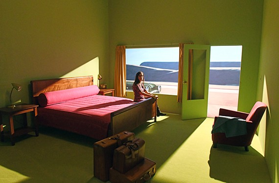 "Amanda Dalla Villa Admas sits inside a re-creation of painter Edward Hopper's ""Western Motel"" at VMFA."