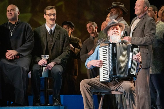 "Local musician and lefty leader of the Breakfast Cabaret, Barry Bless (seated), is embracing the challenge of his performance in Virginia Opera's ""Il Postino."""