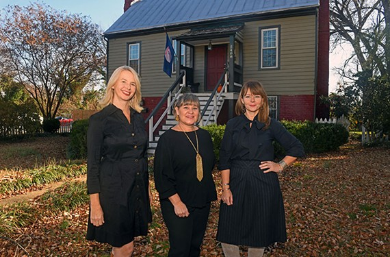 Kelly Trask, Kathryn Oti and Molly Todd stand in front of the historic Weisiger-Carroll House at 2408 Bainbridge St, which was built in 1765.