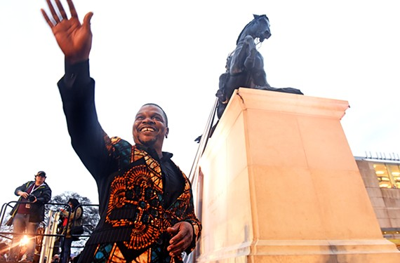 "New York artist Kehinde Wiley waves to an adoring public at the unveiling of his monument, ""Rumors of War,"" in front of VMFA."