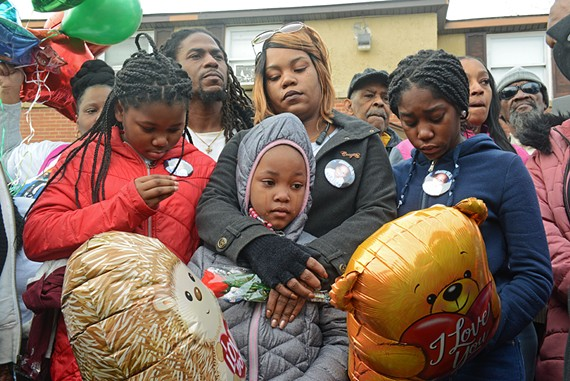 The family of 3-year-old Sharmar Hill Jr., who was killed by gunfire outside his home on Feb. 1. The police believe two groups of people were shooting at each other and are seeking the public's assistance.