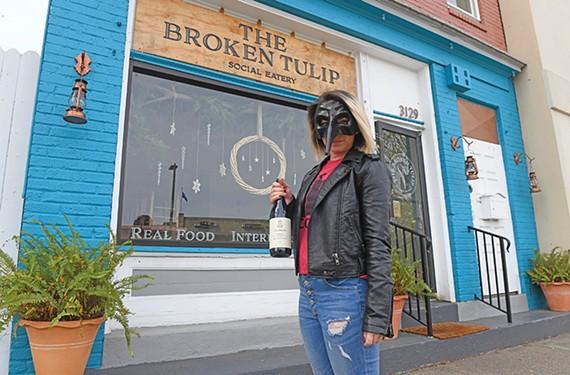 Broken Tulip employee Amanda Faller wears an old-school plague doctor mask on her wine bike deliveries.