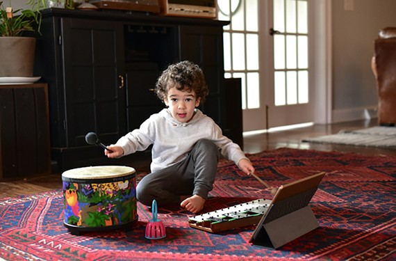Max Anderson, the son of VCU grad Mary Anderson, the co-founder of My Music Starts Here, enjoys some music at home.