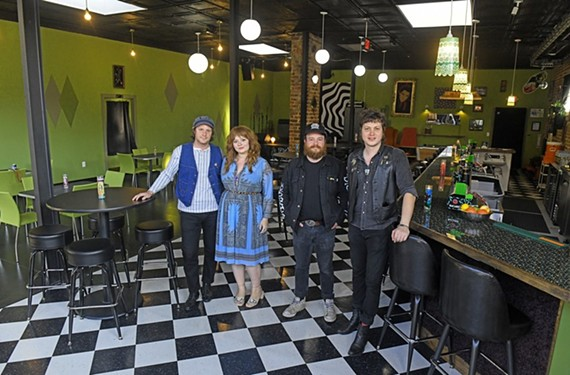 Fuzzy Cactus co-owners Michael Cipollone and his wife, Patty Conway, Drew Schlegel and bar manager Paul Kirk stand inside their restaurant and venue with the '70s basement bar vibe at 221 W. Brookland Park Blvd.