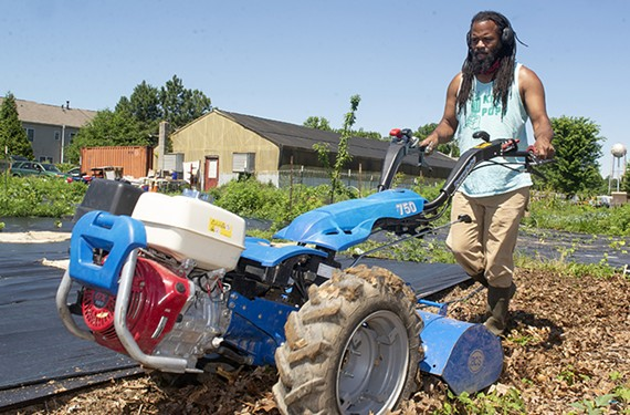 Duron Chavis tills a garden bed at Farm to Family CSA in Mechanicsville.