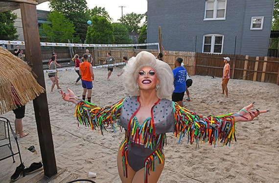Drag performer and comedienne Chicki Parm, aka Chase Keech, poses by the back sand lot of Babe's of Carytown, winner of Best Gay Bar and Best Club for Dancing.