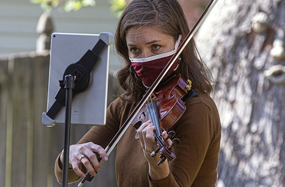 "Violinist Ellen Cockerham Riccio started the series, ""A Violinist in Your Backyard,"" to home-deliver solo concerts during the pandemic. She was hired for as many as 15 shows a week during the summer, she says."