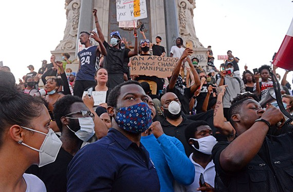Mayor Levar Stoney gazes out at the crowd gathered at the Robert E. Lee monument on June 2. After addressing the protesters by megaphone, Stoney was booed as he left the event.