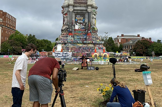 Director Lance Warren, lighting designer Randall Taylor Jr., and director Hannah Ayers film a Richmond Public Schools teacher and cellist, Beth Almore, in front of the Robert E. Lee Monument.