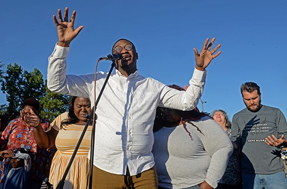 The Rev. Donte McCutchen of Love Cathedral Community Church preaches at a vigil for Jacob Jones on Sept.19, 2019. Jones, 34, was a member of his congregation and drummer in the church band who was killed earlier that week near the 6300 block of Jahnke Road.