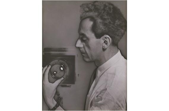 "Man Ray, ""Self-Portrait with Camera,"" 1930, solarized gelatin silver print."