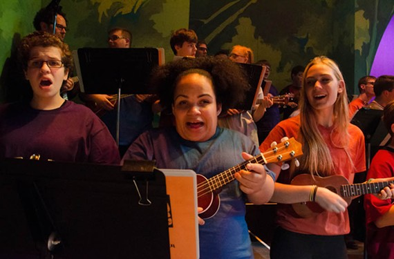 """Sara Rosmarin, Tori Pace and Izabela Clarke perform with the ukulele ensemble from """"Live Art: Tree of Life"""" which took place in December 2013."""