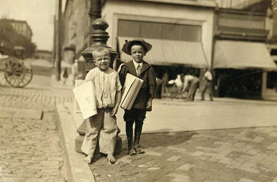 Newsies such as Willie Hutchinson, 6, and Richard Green, 5, were tough-footed salesmen back in the day who did whatever it took to move newspapers. This photo dates from June 1911.