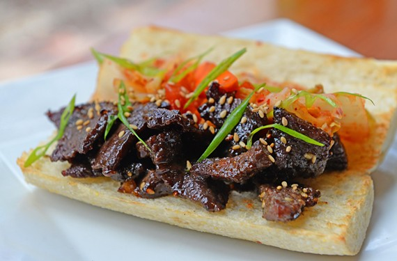 The Cultured Swine's Go Go Gogi is a riff on the Korean classic, bulgogi, and is topped with a kimchi-salsa hybrid on a baguette.