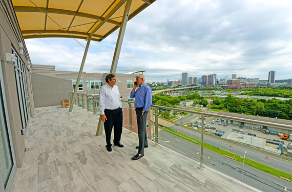 Daniel Gecker and Robin Miller, developers of Terraces at Manchester, confer on the 10th level of their recently completed, 148-unit apartment complex, which offers sweeping views of downtown and the river.