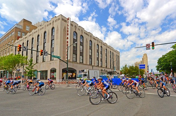 East Broad near Fifth Street and the Greater Richmond Convention Center will be ground zero for the international cycling event Sept. 19-28. Shown here, competitors in the CapTech USA Cycling Collegiate Road National Championship, held here last year, turn onto North Sixth Street off of Broad.