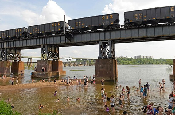 CSX train cars routinely cross a popular swimming spot on the James River.