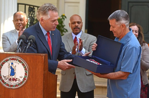 In October, Gov. Terry McAuliffe gives Stone Brewing Co. president Steve Wagner a Virginia flag to fly over the company's new Richmond brewery. The public incentives of the deal have become a sore spot for some local players in the industry.