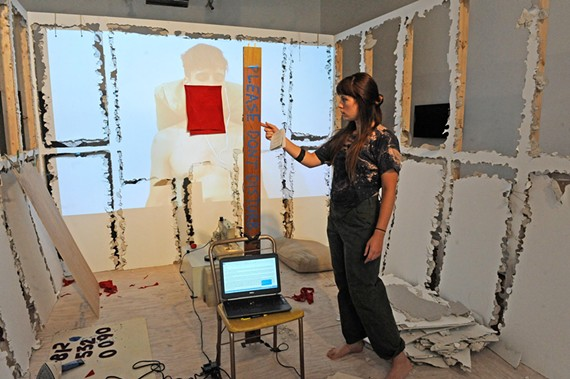 Artist Evelyn Walker works with the space that was left to her at Sediment Gallery by a previous artist, who sledgehammered the walls between bouts of meditation.