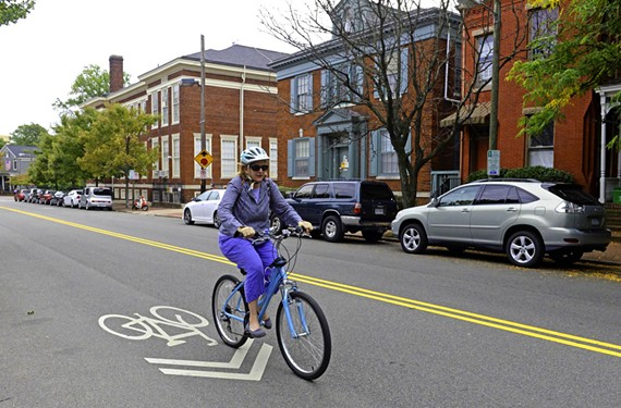Bike sharrows, like this one on Floyd Avenue, tell bicyclists where to ride in a lane shared by drivers. Richmond is big on biking, but there are learning curves.