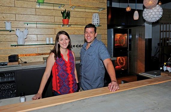 Jessica and Josh Bufford, pictured here in the old Estilo space, have renovated the spot to make way for a new restaurant.
