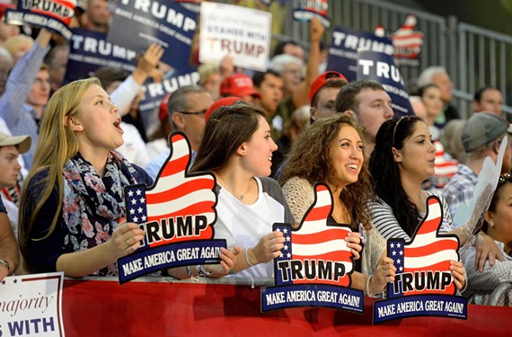 Young supporters attend the Trump rally at the Richmond International Raceway complex two weeks ago. But other millennials came only to observe.