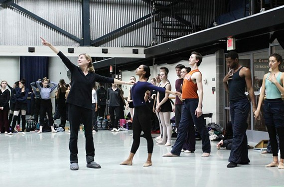 "Artistic Director Stoner Winslett works with company dancer Elena Bello, at center, during rehearsal for the fourth section of her work, ""Windows."""