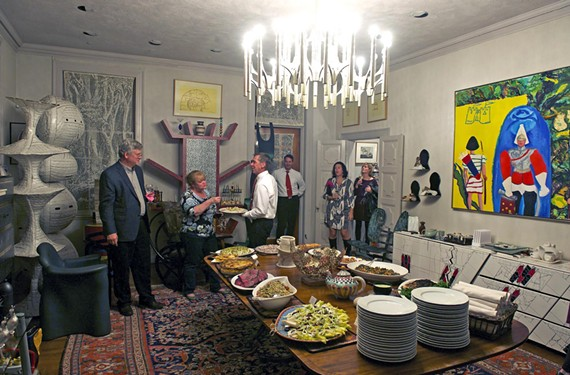 Chef J. Frank's overloaded buffet table for the Fire, Flour & Fork event, Eat Up the Art, matched Frances Lewis' home overflowing with artwork by 20th century masters.