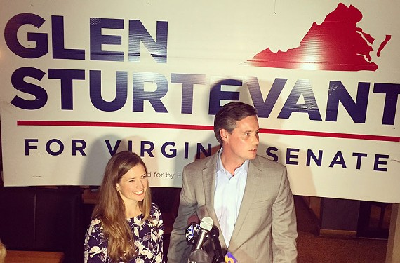 With his wife, Lori, by his side, Glen Sturtevant speaks to supporters at the Blue Goat Restaurant on Tuesday night.