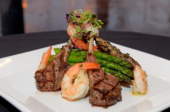 New Zealand lamb chops surrounded by sautéed shrimp and asparagus exemplifies the type of temptingly rich dishes at Shockoe Whiskey & Wine.