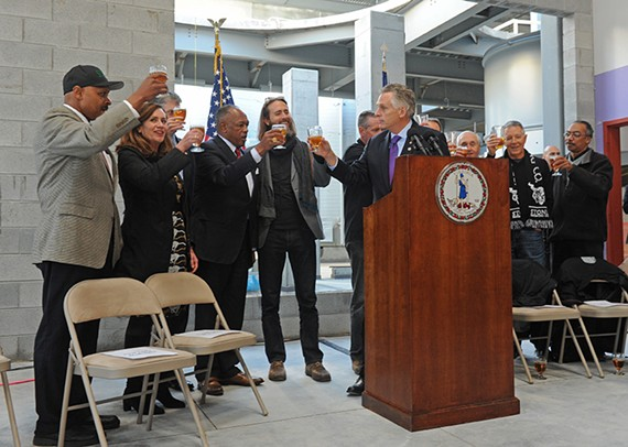 Gov. Terry McAuliffe celebrates Stone moving forward with the construction of its brewery.