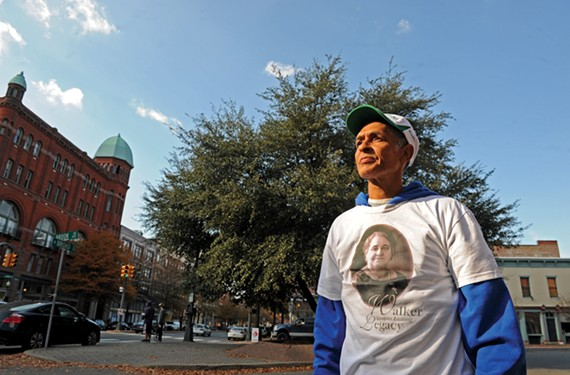 Melvin Jones Jr. stands in front of a triangle at the intersection of Broad and Adams Streets, where the city plans to erect a statue of Maggie L. Walker.