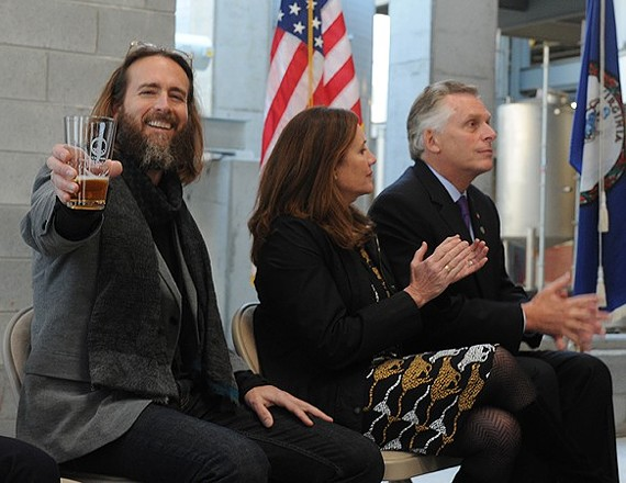 Stone Brewing co-founder Greg Koch raises a glass to celebrate moving forward with the construction of the brewery.