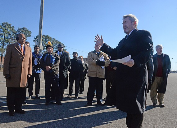 Lee Downey, the city's director of economic and community development, leads Mayor Dwight Jones and city residents on a tour of 60 acres of city-owned real estate on the Boulevard on Wednesday. The tour was held before a meeting hours later to gather community input to shape the future of the site.