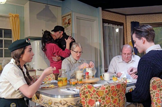 """The cast of 5th Wall and Chamberlayne Actors theater's """"Unexpected Tenderness"""" enjoys a family meal around a sweet vintage table."""