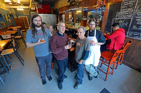 Harrison Steel, Jim Dickerson, James Talley and chef Stephen Henderson relax at the bar of White Horse Tavern in Woodland Heights.