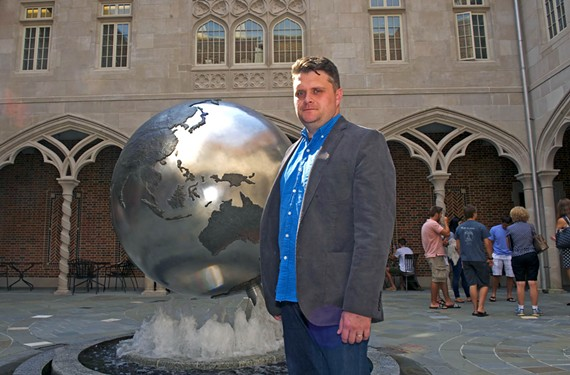 """Timothy Barney, author of """"Mapping the Cold War,"""" stands before the Weinstein International Center at the University of Richmond."""