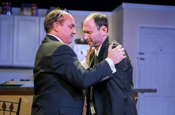 "The brother character, played by Andrew Boothby, attempts to cheer up Elliot, played by Andrew Firda, in the comic drama ""Lazarus Syndrome."" The title refers to a medical diagnosis of survivor's guilt, in this case involving AIDS."