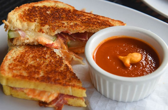 All of Home Sweet Home's grilled cheese sandwiches come with a side of thick, chicken stock-based tomato soup, here paired with the River City composed of pimento cheese, dill pickles and country ham.
