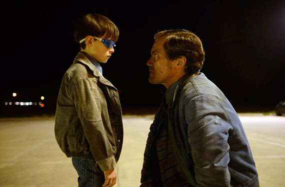 The superherolike Alton (Jaeden Lieberher) gets a talking to from his prominent-jawed dad, Roy, played by Oscar-nominee Michael Shannon.