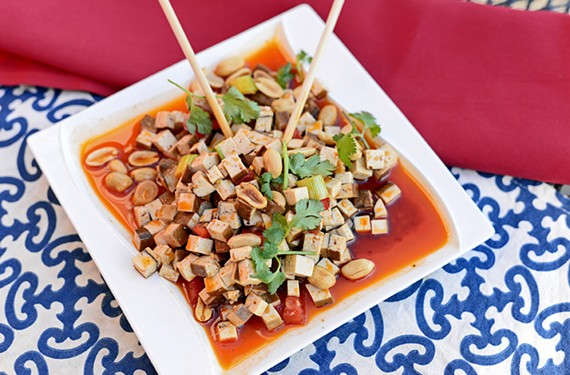 Cheng Du's baked tofu and peanut salad is drizzled in a powerful Sichuan chili sauce that simultaneously heats up and numbs the palate.