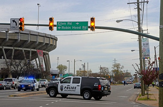 Police swarm the Boulevard outside the Greyhound bus terminal on Thursday, March 31. Shootings resulted in the deaths of Virginia State Police trooper Chad Dermyer and his assailant, James Brown III.