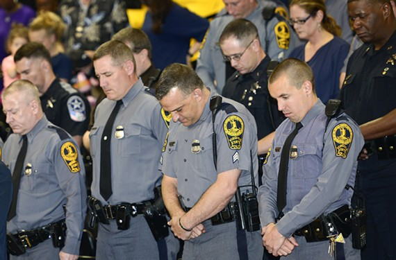 Virginia State Police officers and others pay their respects at a remembrance for Chad Dermyer last week.
