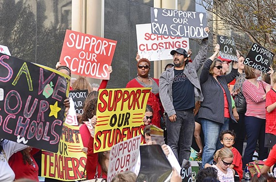 Parents, students and others protest the state of the schools budget at the City Hall rally April 11.