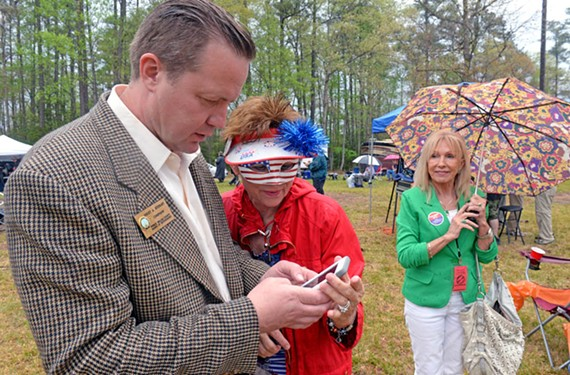 Prince William Supervisor Corey A. Stewart and fellow Republican Amy Butler confer at last week's annual Shad Planking.